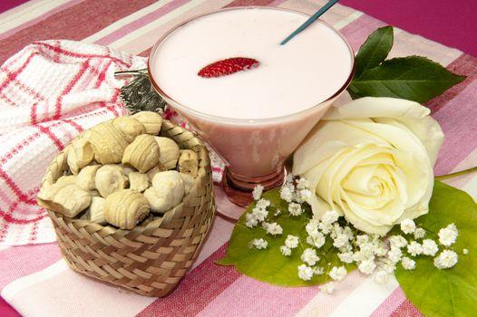 a strawberry yogurt and small sweets Ecuadorians