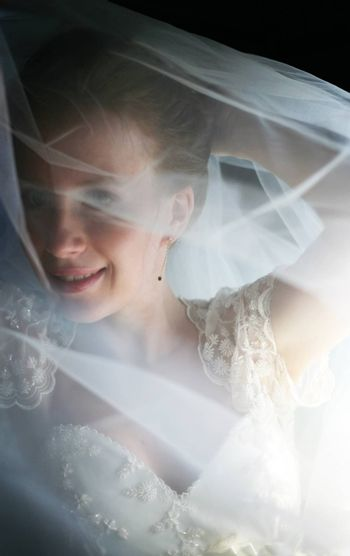 The beautiful bride is closed by a veil