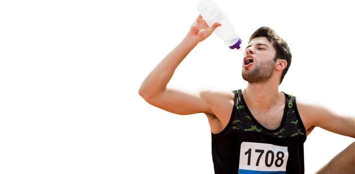 Portrait of sportsman drinking