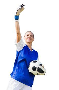 Woman goalkeeper raising an arm