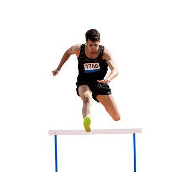 Sportsman practicing hurdles