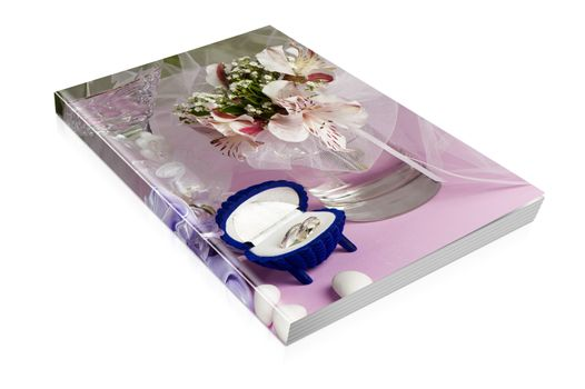book  of  wedding rings and wedding favors on a colorful background