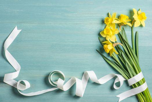 Yellow daffodils and ribbon