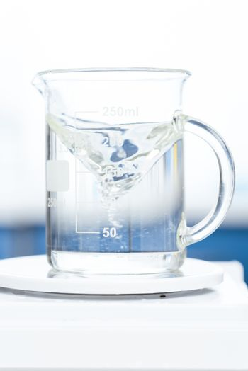 close up view of chemical liquid in laboratory glassware on scales
