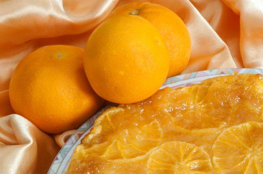 an orange homemade cake on fabric background