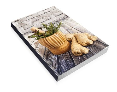 book of Ginger and herbs on a wooden board