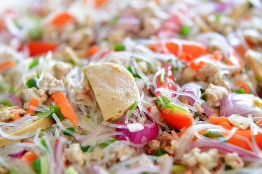 Spicy vermicelli salad with pork, Thai food.