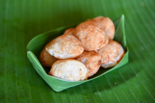 Knmcrk, made from coconut milk with sugar and flour, Thai traditional dessert.