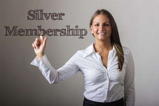 Silver Membership - Beautiful girl touching text on transparent surface - horizontal image