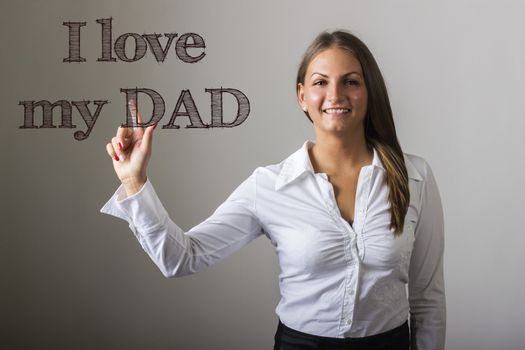 I love my DAD - Beautiful girl touching text on transparent surface - horizontal image