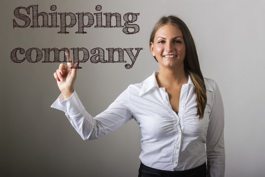 Shipping company - Beautiful girl touching text on transparent surface - horizontal image