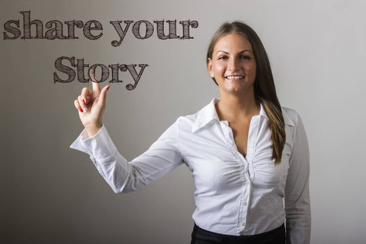 Share your story - Beautiful girl touching text on transparent surface - horizontal image