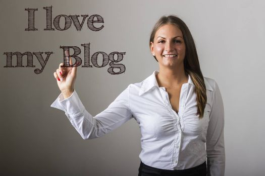 I love my Blog - Beautiful girl touching text on transparent surface - horizontal image