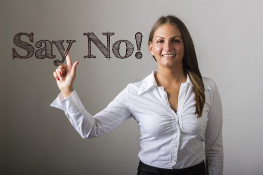 Say No! - Beautiful girl touching text on transparent surface - horizontal image