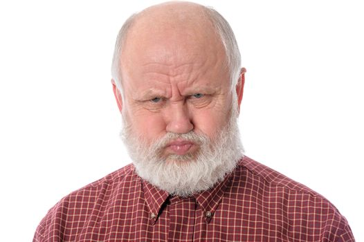 Senior man shows resentful facial expression, isolated on white