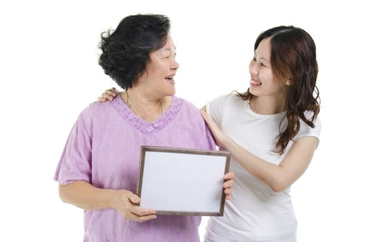 Mother and daughter with blank board