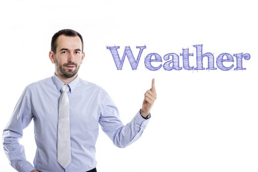 Weather - Young businessman with small beard pointing up in blue shirt - horizontal image