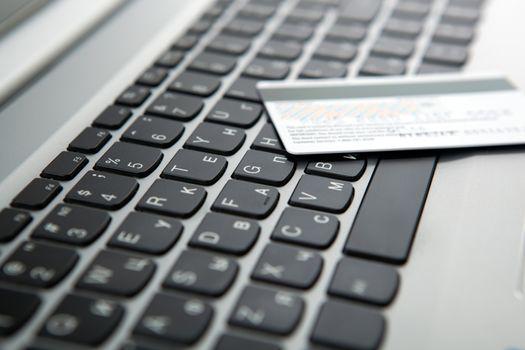 bank card lies on the laptop keyboard