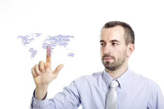 """Young businessman in blue shirt with small beard touching """"World"""" word cloud concept"""