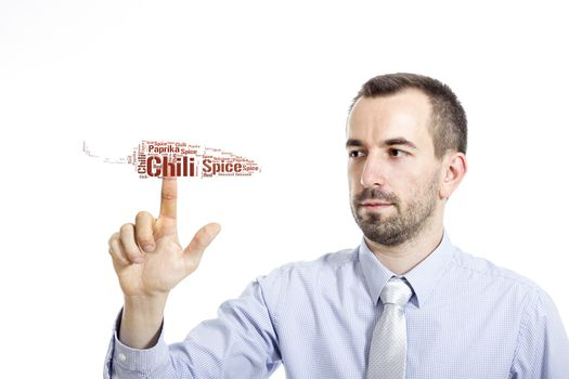 """Young businessman in blue shirt with small beard touching """"Chili"""" word cloud"""