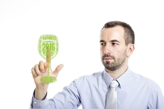 """Young businessman in blue shirt with small beard touching """"New Year"""" glass concept"""