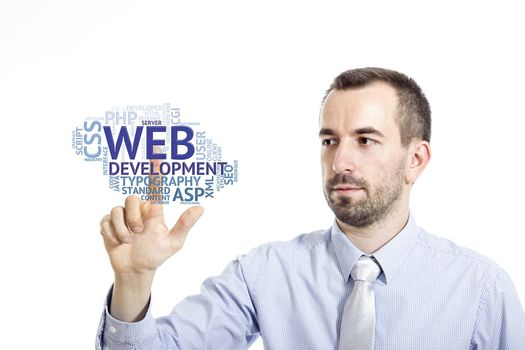 """Young businessman in blue shirt with small beard touching """"Web Development"""" word cloud"""