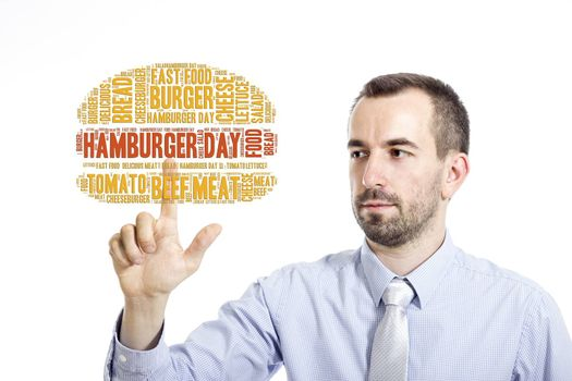 """Young buinessman touching """"Hamburger day"""" word cloud - isolated on white background"""