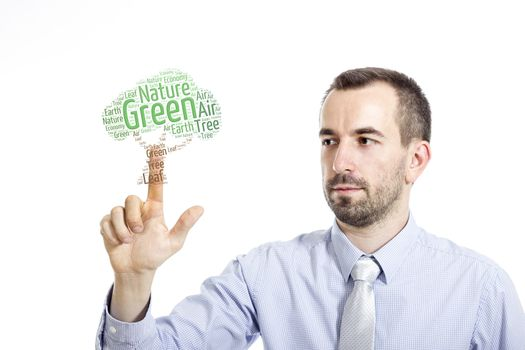"""Young businessman in blue shirt with small beard touching """"Green Nature"""" word cloud"""