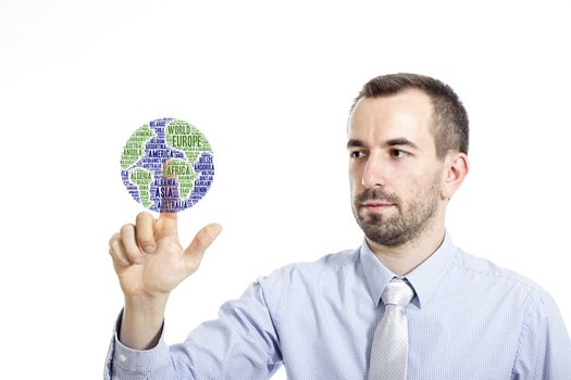 """Young businessman in blue shirt with small beard touching """"Globe"""" word cloud"""