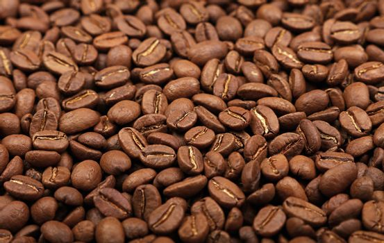 Roasted Arabica coffee beans background high angle