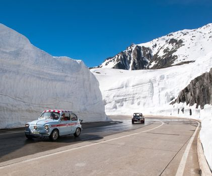 Gotthardpass, Switzerland - May 14, 2015: Beautiful sunny spring day for the day of the Feast of the Ascension. The pass is still a lot of snow in the winter