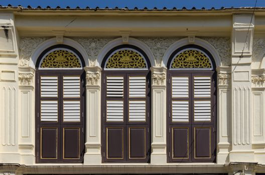 Vintage window with wood shutters.Sino Portuguese style architecture at Phuket