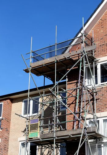 Scaffolding on exterior of modern building