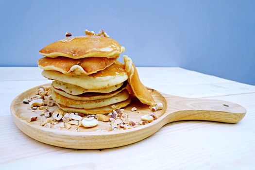 Pancakes with Almonds  in dish on Table wood
