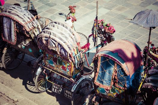 Rickshaw is a very popular type of public transport in cities in