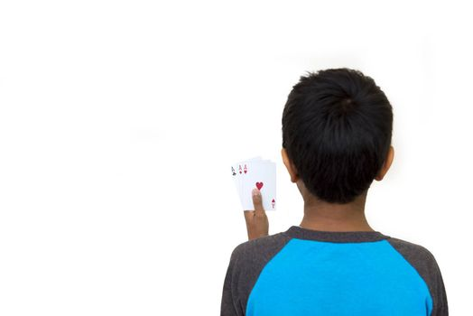 kid holding poker cards on a light background
