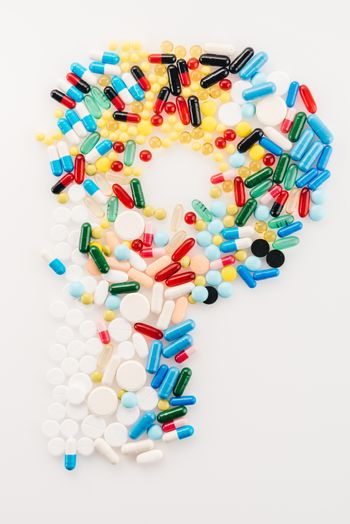 Top view of letter P made from medical pills and capsules, medicine and healthcare concept