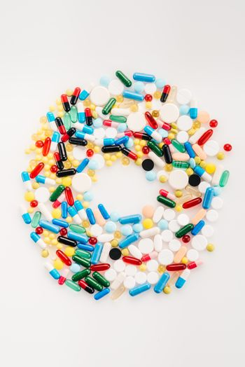 Top view of letter O made from medical pills and capsules, medicine and healthcare concept