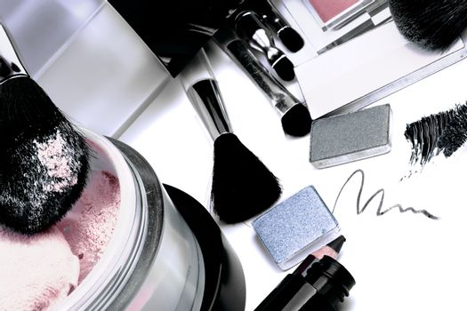 Arrangement of Make up Products with Eyeshadow, Moisturizer, Mascara, Blush, Face Powder and Personal Accessory closeup on White background