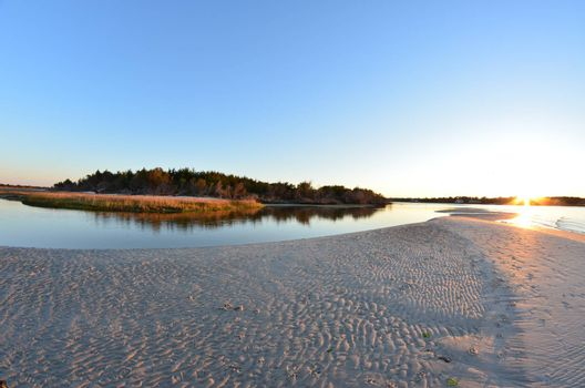 A view of the shore around the north end of Carolina Beach at sunset