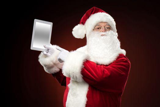 Santa Claus with digital tablet