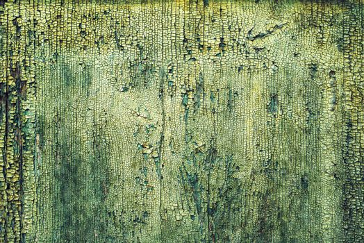 Rough textured surface of old green wooden plank