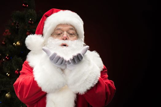 Santa Claus blowing snowflakes