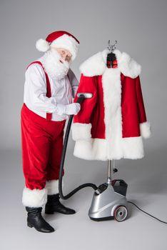 Santa Claus cleaning coat