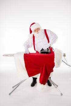 Santa Claus ironing coat