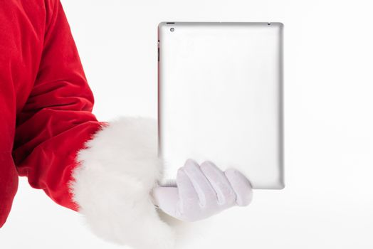 Cropped image of Santa Claus hand showing digital tablet