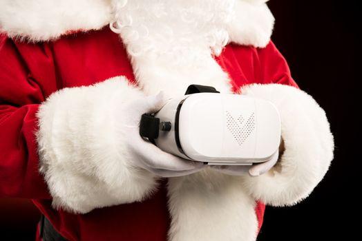 Santa Claus with virtual reality headset