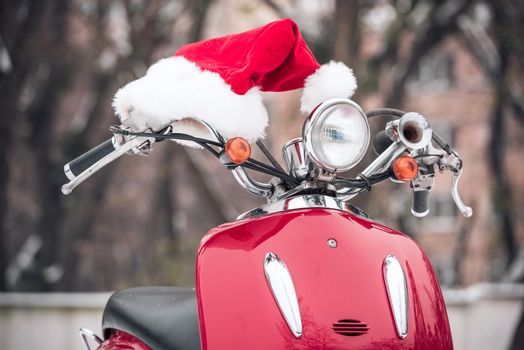 Santa hat on red scooter