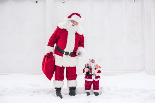 Santa Claus standing with Little Santa
