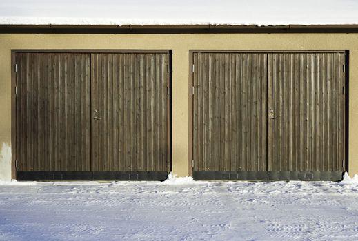 Pair of Garage Doors with snow.